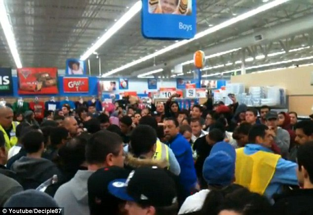 Dozens of Black Friday bargains hunters from a Wal-Mart store in Porter Ranch, Los Angeles were last night drenched in pepper spray when a woman looking for Xbox 360 console deals turned ugly