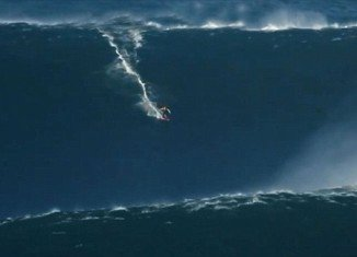 Garrett McNamara, an extreme Irish surfer is set to earn a place in the record books after riding a 90 foot wave in Portugal