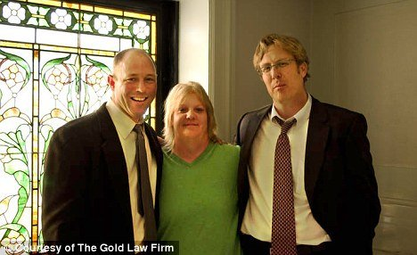 Holly Averyt with her attorneys
