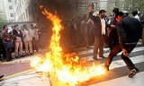 Iranian protesters in the capital, Tehran, have broken into the UK embassy compound during an anti-British demonstration
