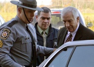 Jill Jones, ex-Penn State coach's former daughter-in-law has obtained a legal order barring Jerry Sandusky' from seeing three of his grandchildren