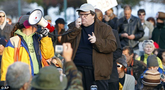 Michael Moore is the booming voice of the Occupy protests, encouraging activists to continue their battle against the wealthy one per cent of Americans, but he has been uncharacteristically quiet about one thing: his own wealth.