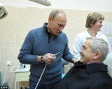 Russian Prime Minister Vladimir Putin took a picture pretending to give Yevgeny Savchenko, Governor of Belgorod, an oral hygiene check at a dentistry center during a campaign visit