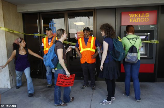 Several windows at a Wells Fargo branch were also smashed by Occupy Oakland protesters