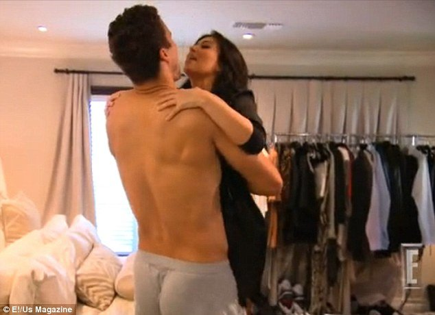 "Struggling to lift Kim Kardashian up, Kris Humphries then says: ""God, you ate a lot of wedding cake,"" before the pair come crashing down onto the bed"