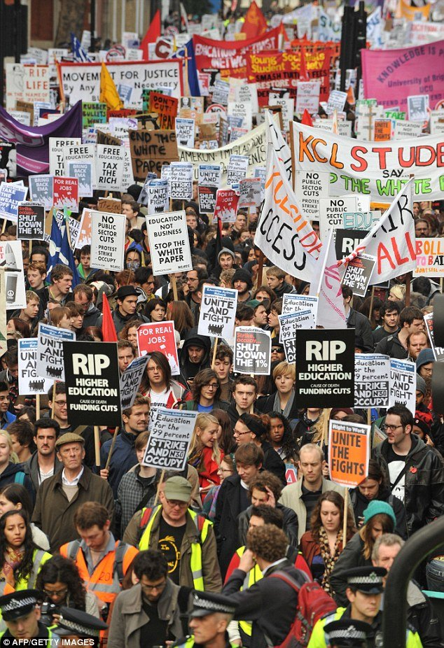 "Students carried placards which read ""Scrap Tuition Fees"" and ""Free Education"""