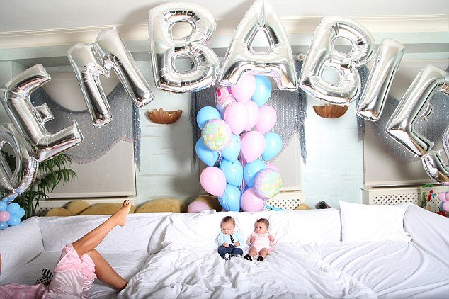 The charming twins, Moroccan and Monroe look like they are on cloud nine as they recline on a giant white sofa with an array of colourful balloons behind them