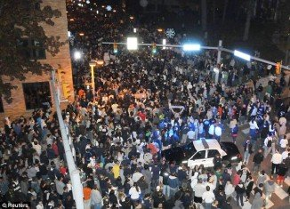 "Thousands of Penn State football fans took the streets last night at the announcement their long-term head coach Joe Paterno would be sacked with ""immediate effect"" for his role in the sex scandal which has rocked the university"