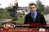 WTVW reporter Drew Gardner was doing a storm damage report in Carmi, Illinois, as a man was using a chainsaw near a fallen tree behind him