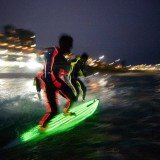 17 Strongbow-sponsored surfers took to the water for the largest ever glow-in-the-dark surf attempt in front of hundreds of fans who lined Bondi Beach in Australia