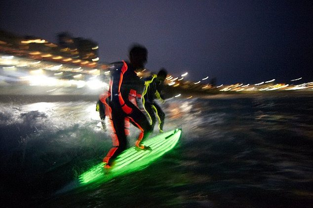 17 Strongbow sponsored surfers took to the water for the largest ever glow in the dark surf attempt in front of hundreds of fans who lined Bondi Beach in Australia photo