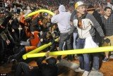 At least 13 people have been injured, including two in critical condition, after thousands of fans stormed the field and tore down goalposts after Oklahoma State's 44-10 victory over archrival Oklahoma last night