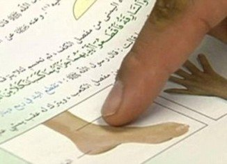 Barbaric textbooks which were handed out in Saudi Arabian schools teach children how to cut off a thief's hands and feet under Sharia law