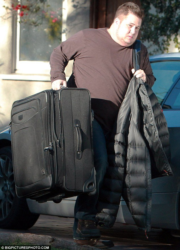Chaz Bono, 42, was pictured leaving the LA residence with a large suitcase just days after announcing the end of his engagement with Jennifer Elia