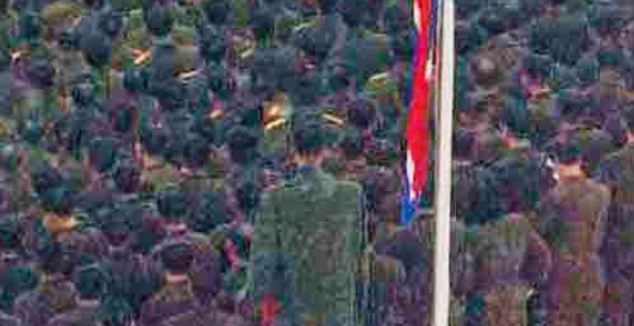 Footages from Kim Jong-Il's funerals showed an 8ft member of the North Korean armed forces towering beside his fellow soldiers in the driving snow