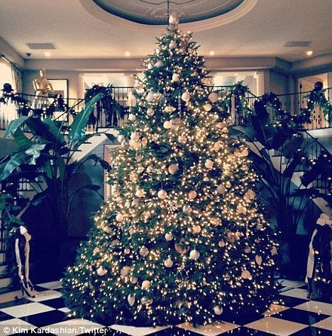 Kim Kardashian posted a picture of Kris Jenner's luxury ornament bedecked tree today, which looked very expensive and very neutral