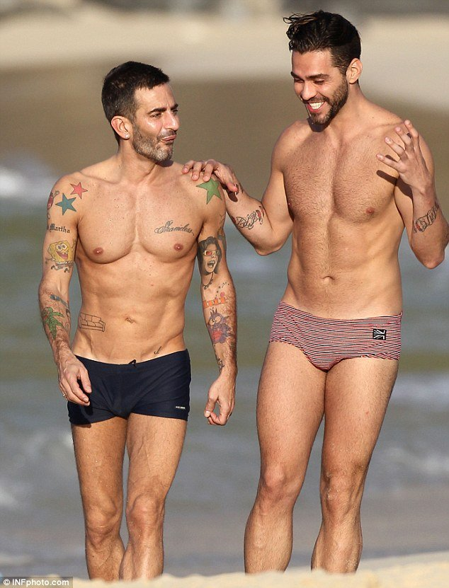 Marc Jacobs, 48, showed that he's still keeping in great shape by flaunting his incredibly ripped beach body as he walked along the St. Barts beach with his equally muscular ex-fiance Lorenzo Martone