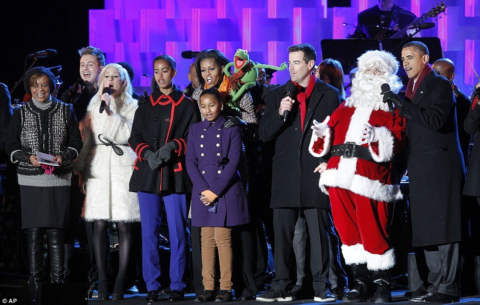 President Barack Obama, First Lady Michelle Obama, and their daughters Sasha and Malia took the stage next to Santa Claus and Kermit the Frog and officially marked the start of the Christmas season