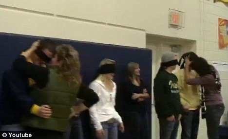 Rosemount High School winter-sport team captains were blindfolded as their mothers and fathers approached and kissed them