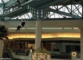 Santa was embarrassed when his beard and hair got stuck in rope while repelling into Palm Beach Gardens Mall, Florida, while horrified children watch
