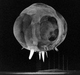 """The """"Rapatronic"""" camera - an ultra-high-speed camera that sat seven miles from the blast site and captured images at high speed - including this image of an 100-ft ball of fire, one ten-millionth of a second after detonation"""