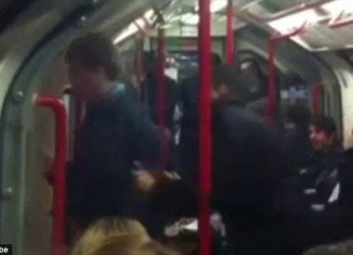 The video clip shows the dancing man happily ignoring fellow passengers as he boogies to the music playing through his headphones was shot by a fellow passenger seated further along the carriage