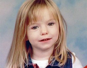 Two officers from Scotland Yard investigating the disappearance of Madeleine McCann have flown to Spain as part of a review into the case