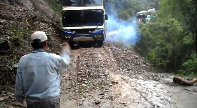 A shocking video captures the moment a double-decker bus plunged off a cliff on Camino de la Muerte, the world's most dangerous road, in Bolivia