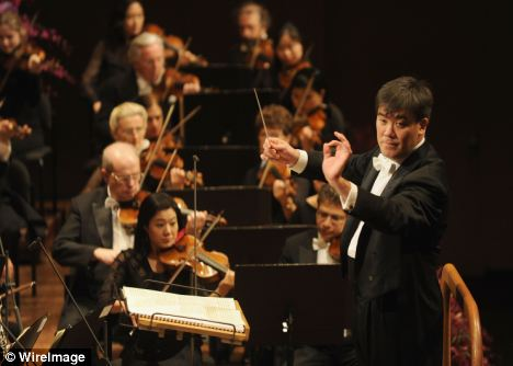 Alan Gilbert, the New York Philharmonic orchestra music director, stopped the orchestra in its tracks when a mobile phone went off during a performance