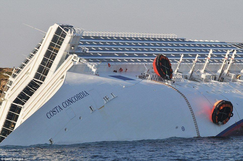 Divers searching the wreck of Costa Concordia cruise ship have found the body of a woman bringing the death toll to 17 photo