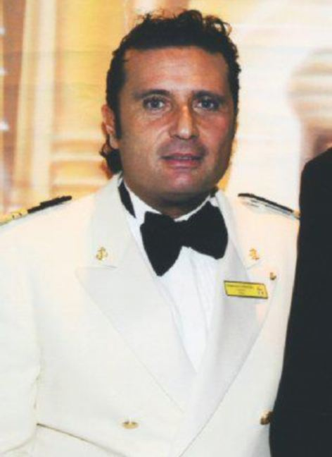 "Francesco Schettino had been drinking ""with a beautiful woman"" at the ship's bar before he sailed into disaster"