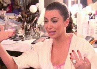 Kim Kardashian has a breakdown on the finale of Kourtney & Kim Take New York, sobbing uncontrollably to older sister Kourtney