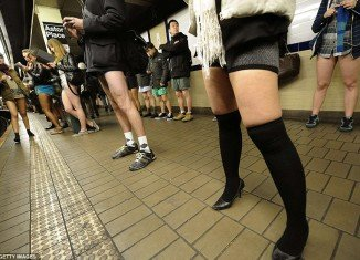 People throughout New York City stripped to their underwear as part of the worldwide practical joke No Pants Subway Ride, organized by prankster group Improv Everywhere
