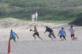 President Barack Obama stripped off for some beach football to round off his Christmas holidays in Hawaii