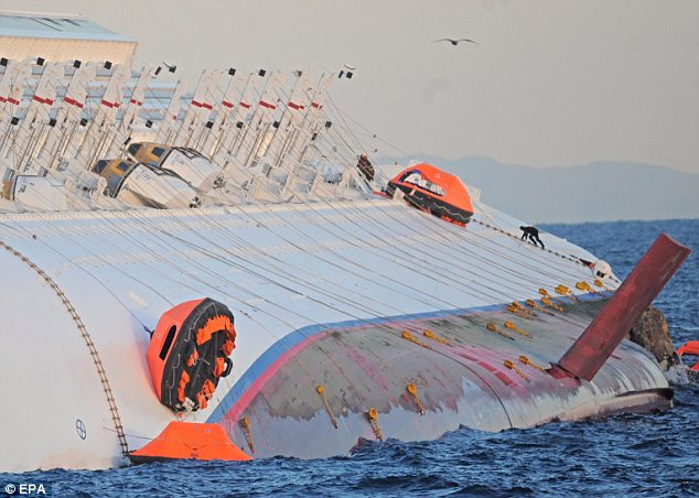Rescue teams have found five more bodies inside the Italian Costa Concordia stricken cruise ship raising the confirmed death toll to 11 photo