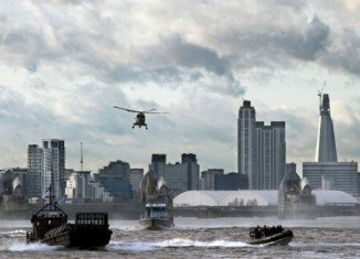 Royal Marines and Scotland Yard took command of the River Thames yesterday in a determined show of strength as part of a security exercise for the London Olympics called Operation Woolwich Arsenal Pier