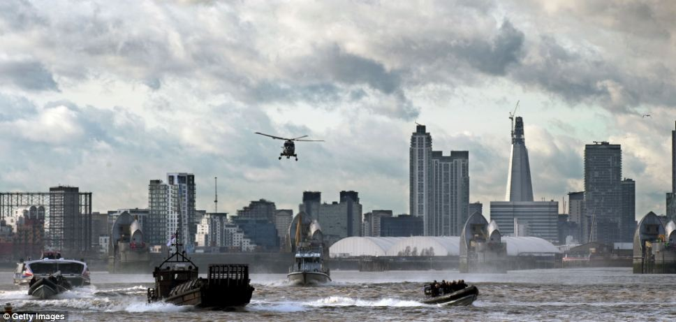 Royal Marines and Scotland Yard took command of the River Thames yesterday in a determined show of strength as part of a security exercise for the London Olympics called Operation Woolwich Arsenal Pier photo