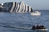 The death toll of Costa Concordia cruise ship disaster is raised to 13 after divers have found the body of a woman in the wreck of vessel