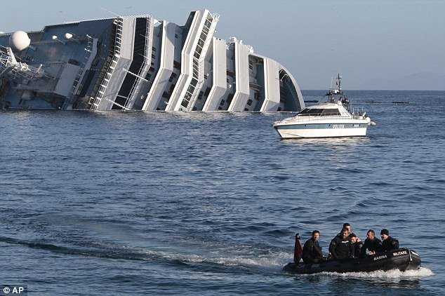 The death toll of Costa Concordia cruise ship disaster is raised to 13 after divers have found the body of a woman in the wreck of vessel photo