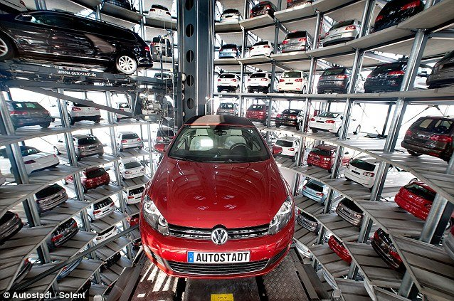 Volkswagen Autostadt CustomerCenter futuristic garages are the ultimate car showrooms with millions of dollars worth of new vehicles sitting in the stunning glass towers