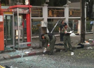 According to Thai officials, a man thought to be Iranian has had both legs blown off after attempting to throw a bomb at police in the country's capital Bangkok