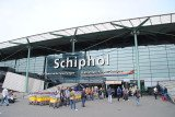 Amsterdam's Schiphol airport has been evacuated after Dutch police has arrested a man who locked himself in a toilet and claimed to have a bomb