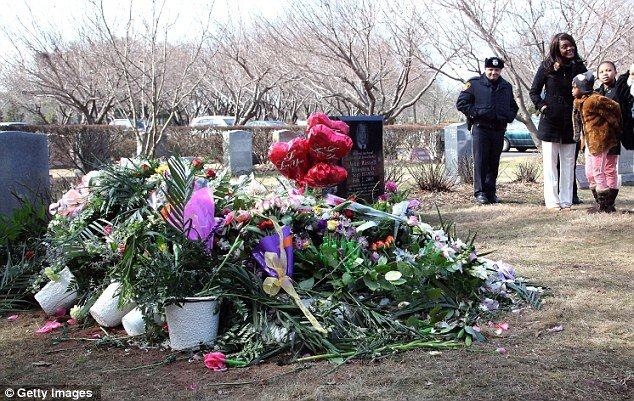 Armed security guards have been placed at Whitney Houston's grave to prevent grave robbers from plundering $500,000 worth of jewels and clothing the singer was buried in
