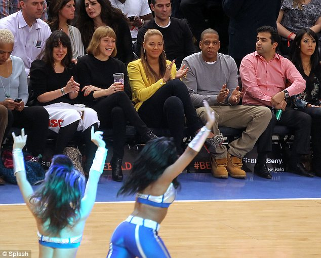 Beyoncé and Jay-Z made their first public appearance together since their daughter Blue Ivy was born at a basketball game