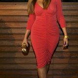 Beyoncé made her first public appearance after she gave birth to her baby daughter last month in a simply striking red dress to showcase her enviable figure without a hint of an unwanted lump or bump