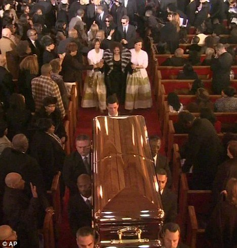 "Carolyn Whigham, the owner of the funeral home that handled Whitney Houston's remains is said to be ""devastated"" that a photo showing the legendary singer's body in an open casket was leaked to the National Enquirer"