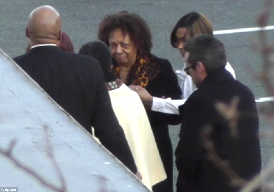 Cissy Houston was escorted into Whigham Funeral Home by a priest and held hands with a woman in a crisp white shirt