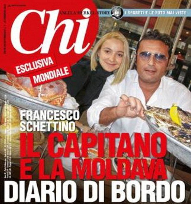 Domnica Cemortan and Francesco Schettino pictured at a restaurant table groaning under the weight of fresh oysters and crabs during a stop over on a previous cruise