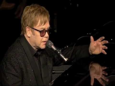 Elton John said his shows in Las Vegas were cut because he was sick with food poisoning, not because he was attending Whitney Houston's funeral