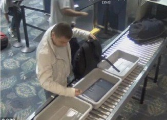 Florida police is searching for a man caught on camera stealing a $6,500 Rolex watch from a fellow passenger at an airport security checkpoint
